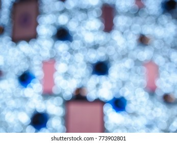 Blurred photo of Colorful Christmas Tree Bokeh background of defocused glittering lights, Christmas background.