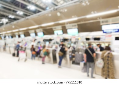 Blurred photo of counter Check in airport in Suvarnabhumi airport in Thailand.