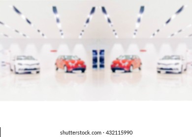 blurred photo de focused new car in  showroom : for background use