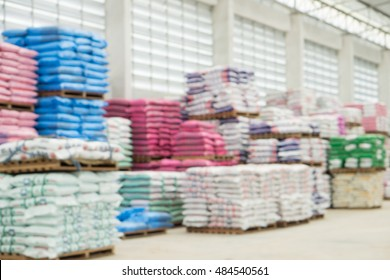 Blurred photo of fertilizer bags on big store.