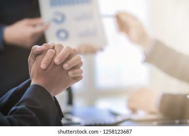 blurred photo, A group of business people who are discussing strategies for investing, doing business to succeed and progress. Businessmen are meeting to summarize annual statistics.