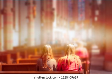 Blurred photo inside of a church - People praying in a church