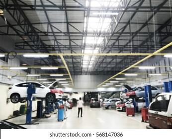 blurred photo of interior of auto repair center.
