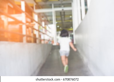 Blurred photo of Little girl run away from Thief is stealing kidnapped little girl in supermarket. Children kidnapping concept.