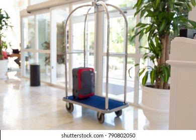 Blurred photo of a luggage cart in a hotel hallway lobby