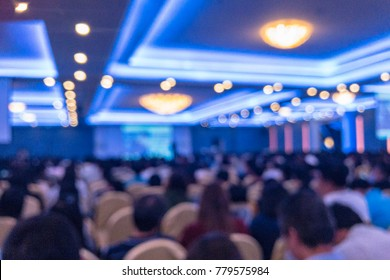 Blurred photo of meeting or seminar in auditorium or conference hall