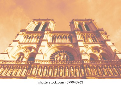 Blurred photo of Notre Dame Cathedral. Paris (France). Toned photo.