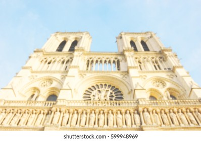 Blurred photo of Notre Dame Cathedral. Paris (France)