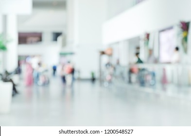 Blurred photo with people at airport, defocused silhouettes indoors, unrecognizable persons, abstract background, empty place for text,  copy space, motion blur.