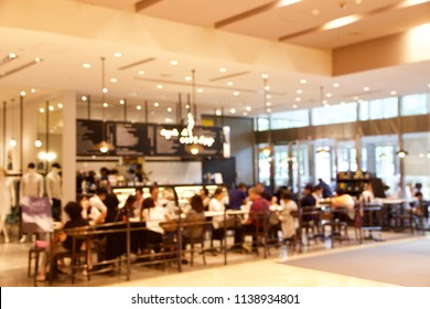 The blurred photo of the people meet and have leisure time at the coffee shop corner in a shopping mall.