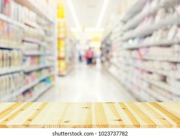Blurred photo of products in shelf for shopping background.