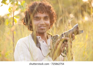 Blurred photo of Professional photographer are shooting in a meadow during sunset.