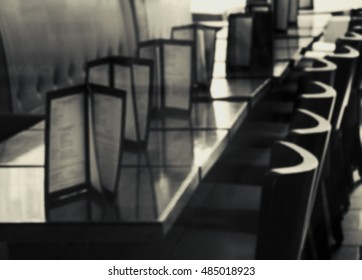 Blurred photo of restaurant interior. Black and white.