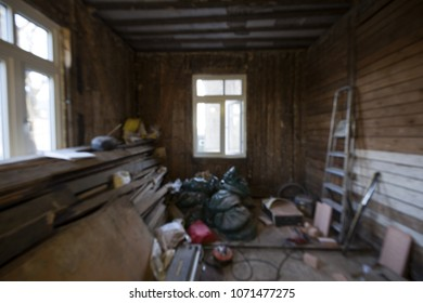 Blurred photo of room with tools and materials all around, before renovation.