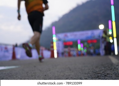 Blurred photo, The runner is running into the finish line.