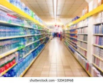Blurred photo of shelves with products in the supermarketa