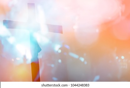 Blurred photo of Silhouette cross of Crucifixion Of Jesus Christ.Concept for faith religion, christian worship, Easter, Redeemer Thanksgiving and praise.Worship concert background for Good friday