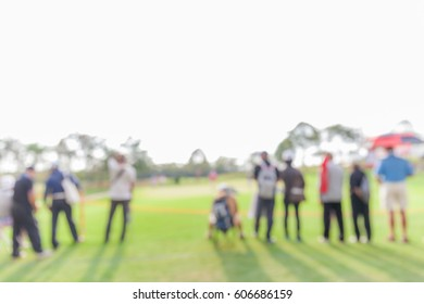 Blurred photo of spectators are looking the match in golf tournament.