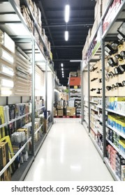 blurred photo of store shelves of lighting in the warehouse.