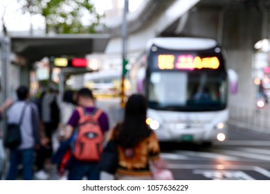 The blurred photo of travelers waiting the coming bus at rush hour. The cityscape of transportation in Taipei, Taiwan.