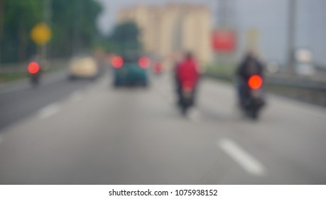 Blurred photo of vehicle on highway