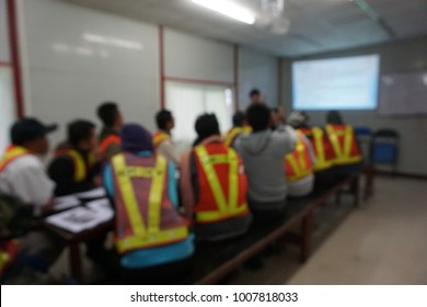 Blurred photograph of on construction site presentation with peoples who wear reflective safety jacket
