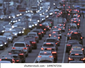 Blurred photography of cars motion. Big traffic in city. In the summer urban highway filled cars. Rush hours. To be late. Suitable for greeting card design, background, postcard template, poster