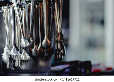 blurred photo,Ice tongs are prepared in ice barrels for use in ice tongs and mixing drinks for customers. The concept of preparing equipment for customer service such as ice tongs in the bartender