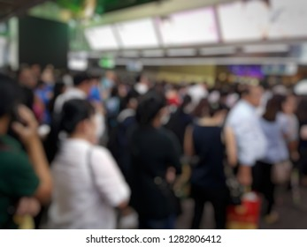 Blurred picture of crowd at BTS station that waiting for BTS. Trasportation concept.