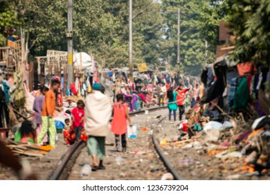 Blurred picture of daily life of poor people in a slum in Kolkata. In Kolkata there are over 70,000 people who are homeless and almost one-third of the total population live in slums.