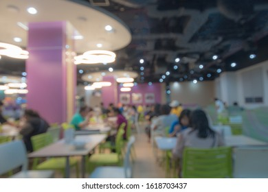 Blurred picture of dining area in colorful pastel public canteen (school, hospital, office or campus) Use for modern style space. Copy space.