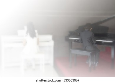 Blurred picture of girl musician playing white piano and boy playing black piano white and black tone background, concept of Ying Yang harmony