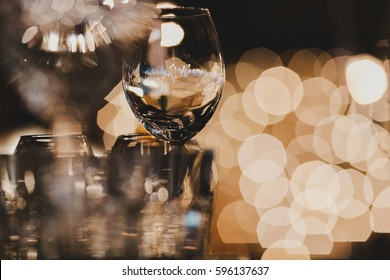 Blurred picture of glassware standing on the table