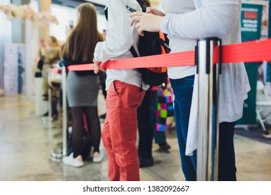 Blurred picture of Long Passenger Queue Waiting for Check-in at Airport Check-in Counters.