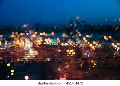 A blurred picture of a night city in the rain