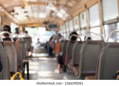 Blurred picture on the bus and people sitting.Transportation public in Bangkok Thailand.