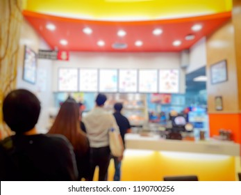 It's a blurred picture of people are line up for order fast food. Fast food concept. Junk food.
