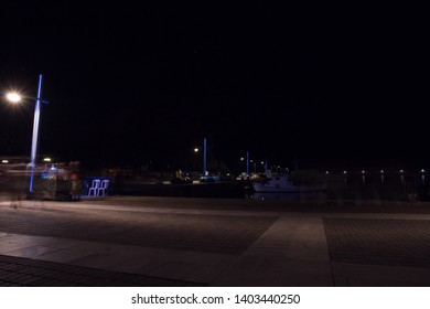 Blurred picture, with street lights and people, in Kalamata, Greece.