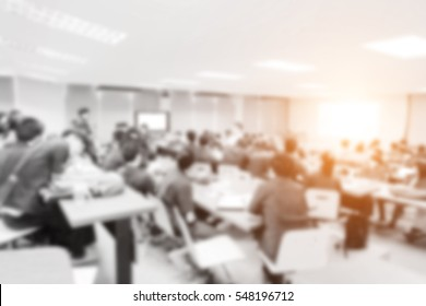Blurred picture of student during study or exams from teacher,professor in classroom at university. Abstract background people learning,testing,training group. Lecture,meeting about education.
