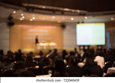Blurred picture of student during study or exams from teacher,professor in classroom at university. Abstract background people learning,testing,training group. Lecture, or meeting about education.