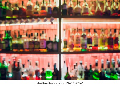 Blurred picture of vintage lamps with liquor bar.