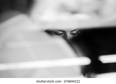 Blurred picture of woman sitting with closed eyes