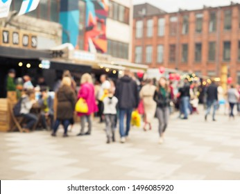 blurred pictures of people at street feast cafe