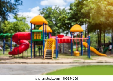blurred of playground on day noon light in city park.