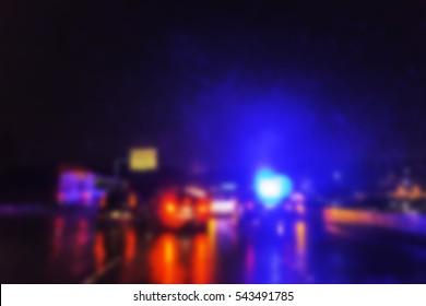 blurred police lighting in the dark.