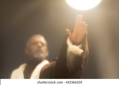 Blurred Portrait of preaching medieval monk in church