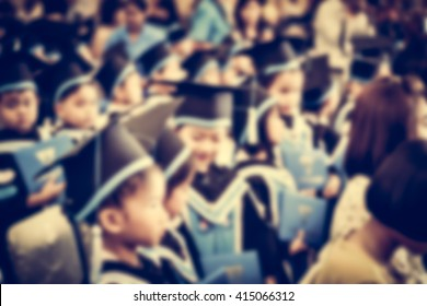 Blurred pre-school children getting ready for their graduation. People background