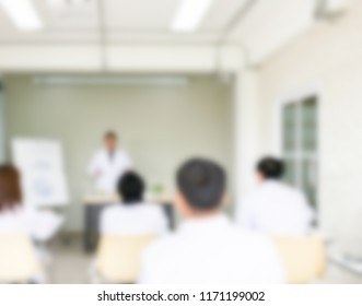 Blurred of professor or doctor teaching about the lab fish anatomy to young scientists and veterinarians doctor. Shooting picture from the back of room.