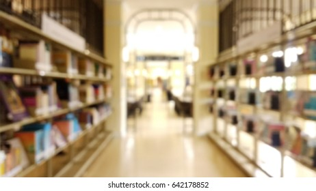 blurred of public city Library background, warm lighting tone.
