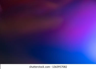 Blurred purple and blue color gradient. Glowing abstract background. Lens flare effect.